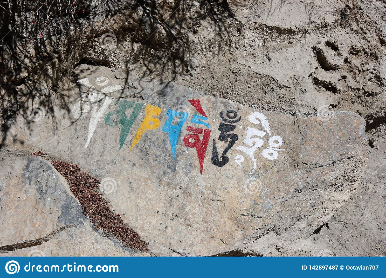 Nepalese religious symbol writing on a rock