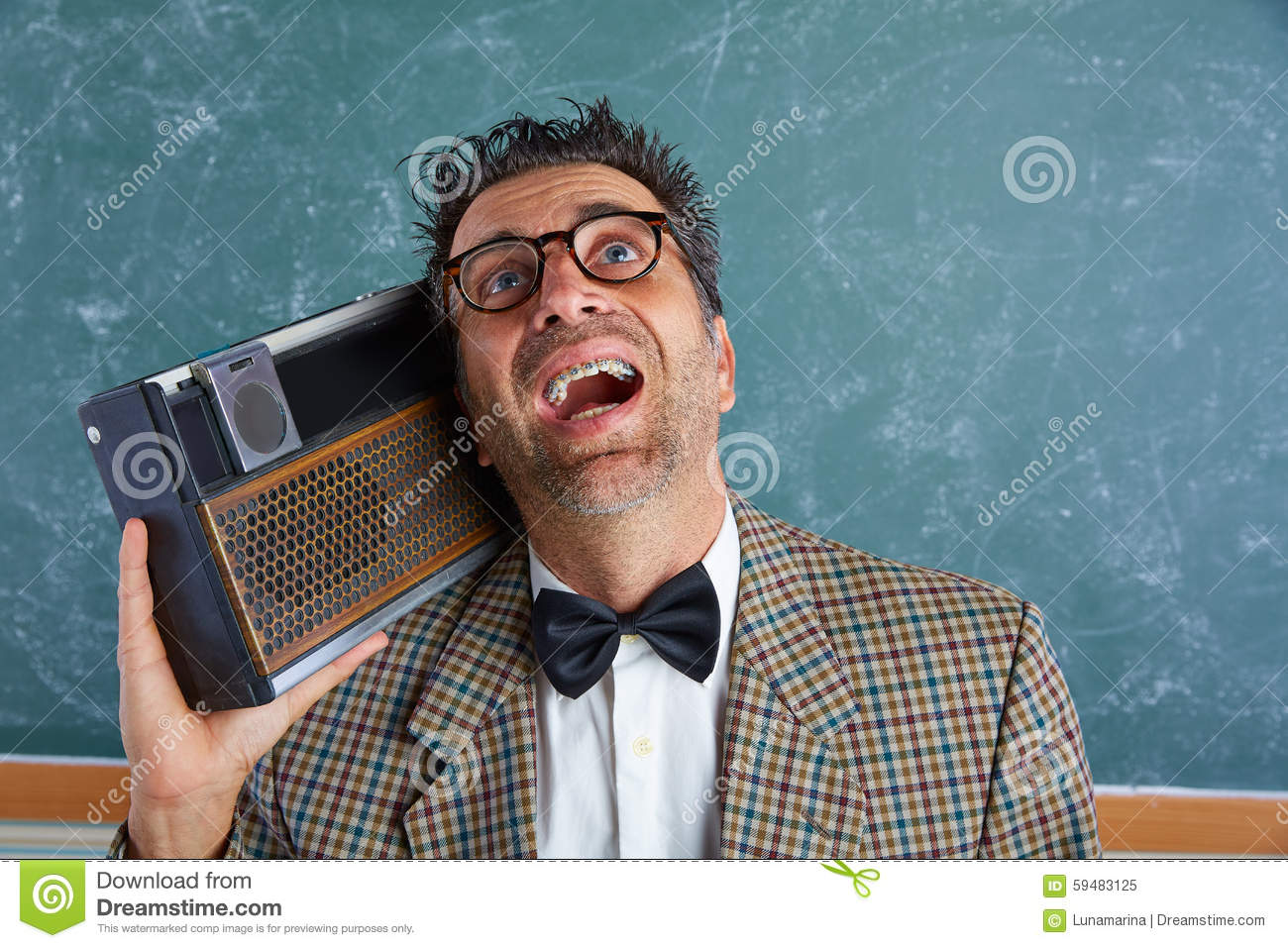 Nerd silly retro man with braces and vintage radio