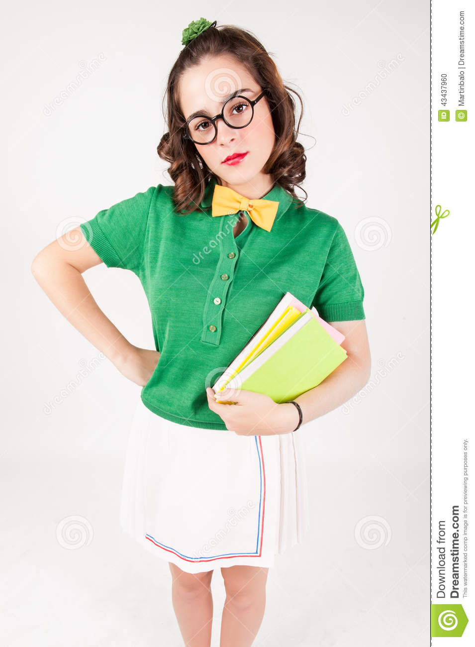 Nerdy Girl Holding Books Looking At Camera Stock Photo -9239
