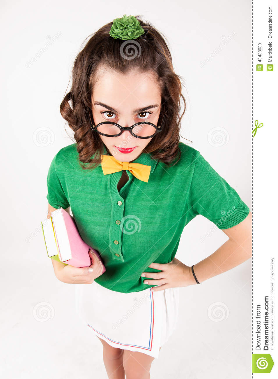 Nerdy Girl Holding Books Looking At Camera Stock Photo -4316
