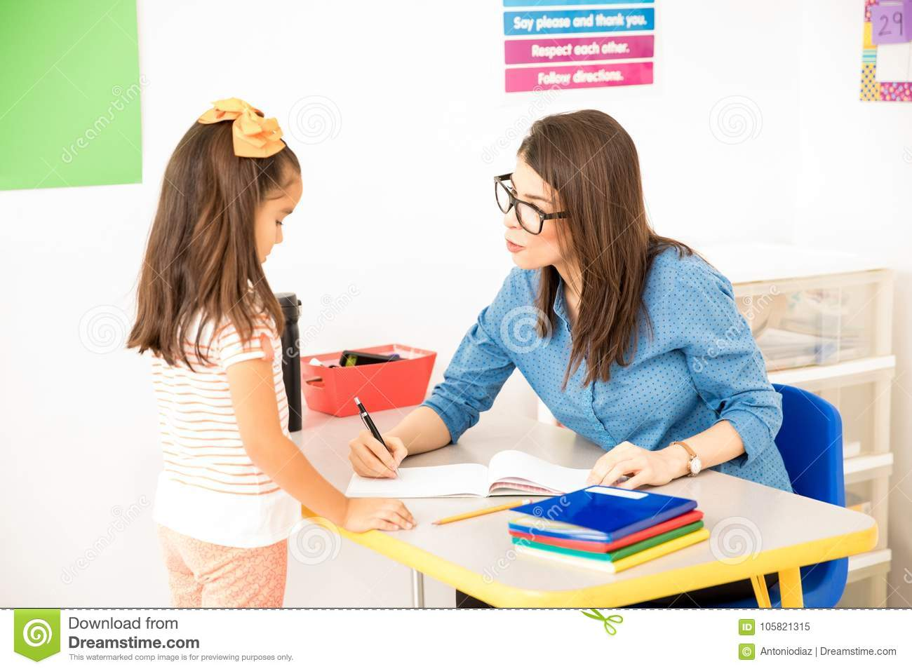 teacher grading a student s work stock image image of student