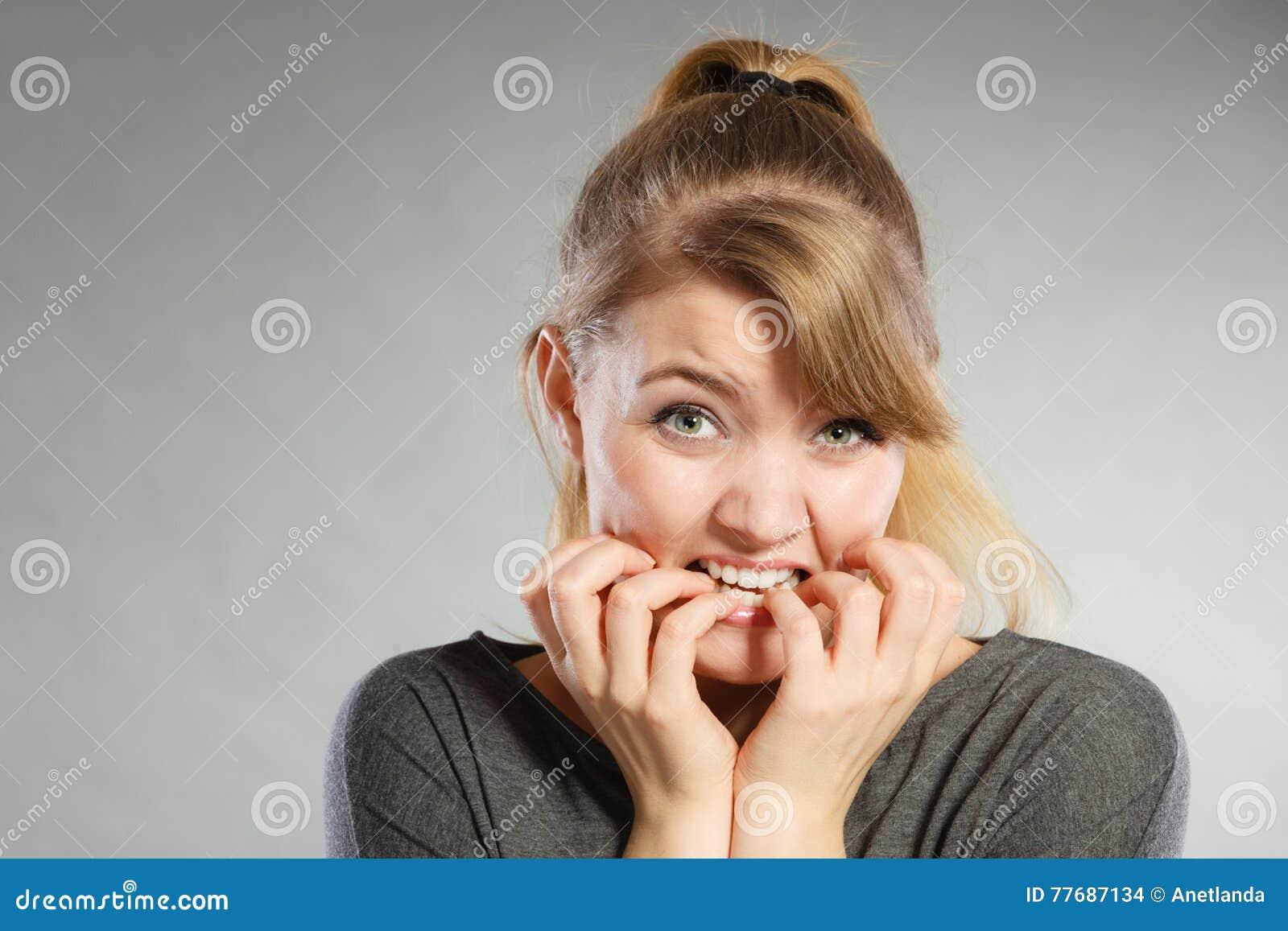 Nervous girl biting nails.