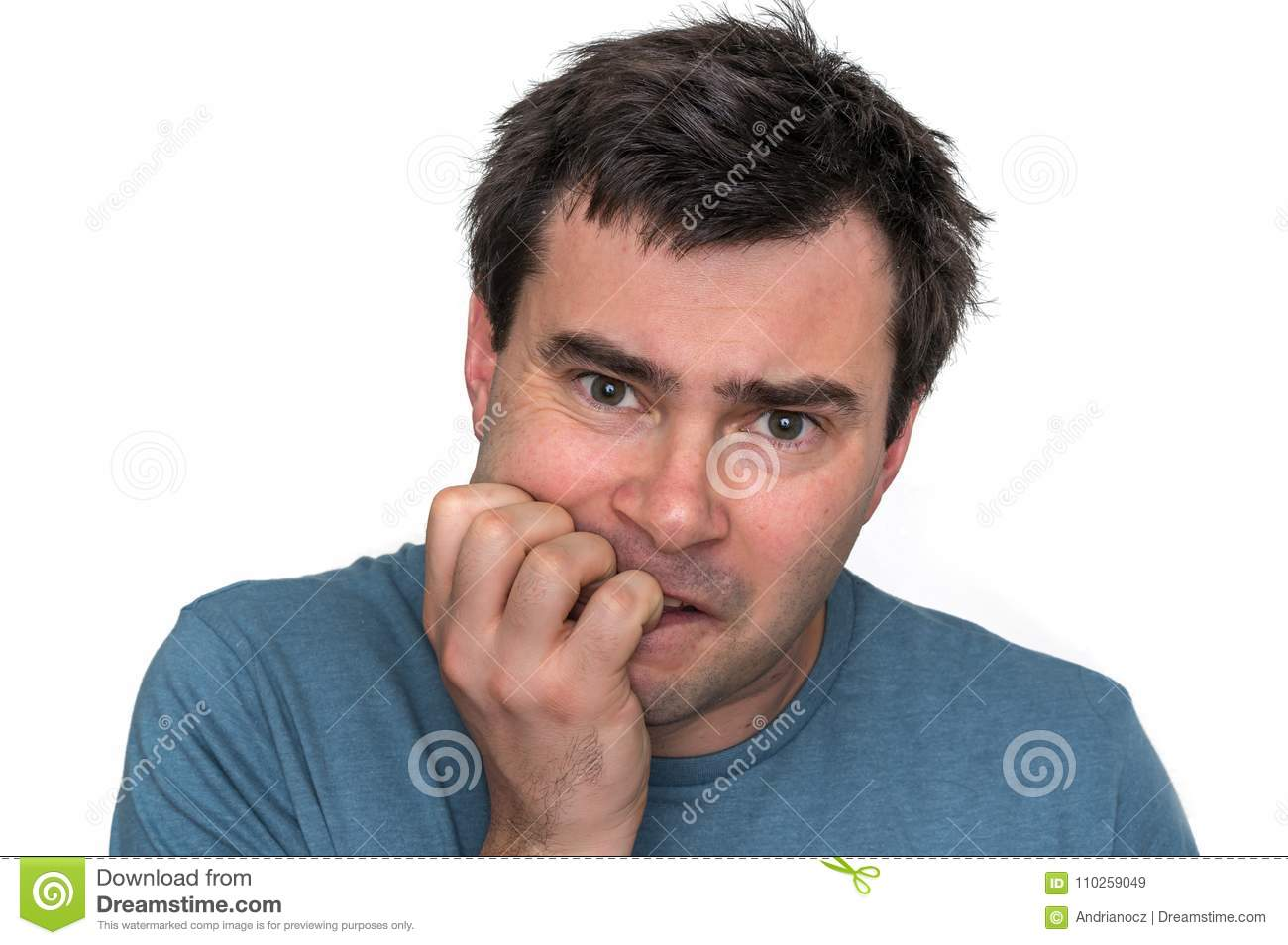 Nervous man biting his nails isolated on white