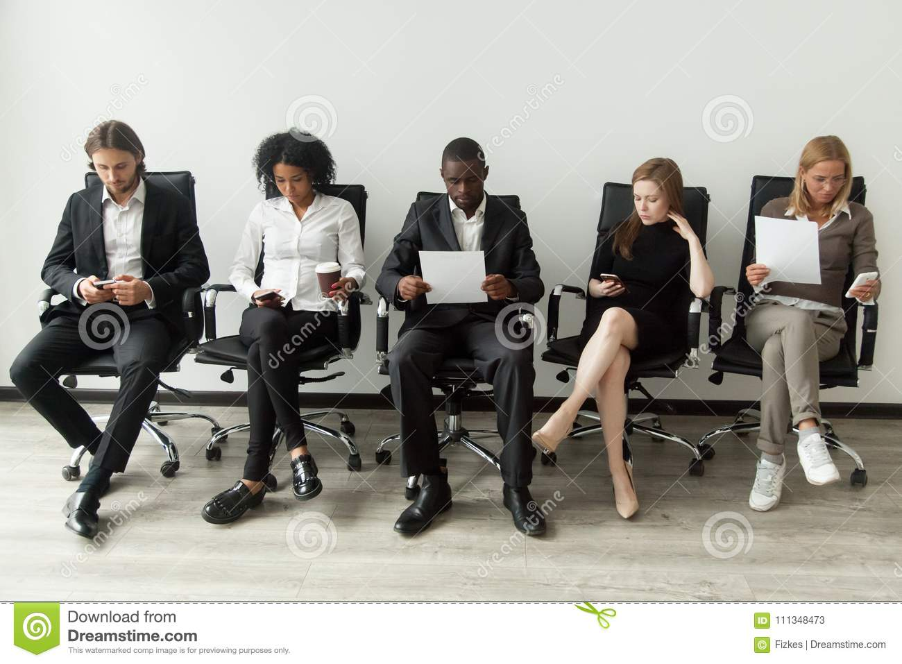 Nervous stressed job applicants preparing for interview waiting