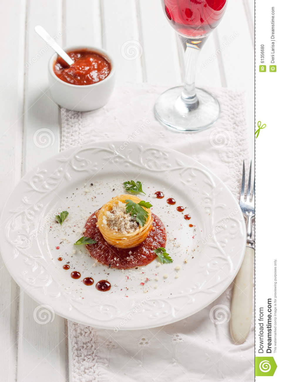 Muffins from spaghetti with cheese and meatballs on a white background ...