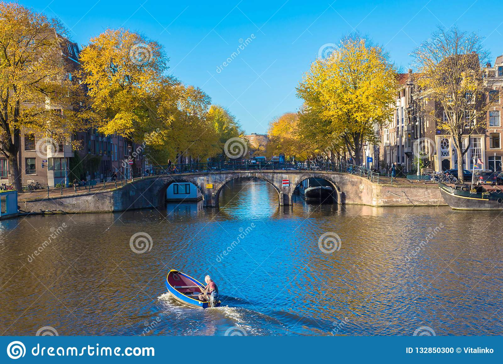 November 8, 2018. Amsterdam, Noord-Holland, the Netherlands. Amsterdam  canals. Old houses along the canals. Bridge and boat