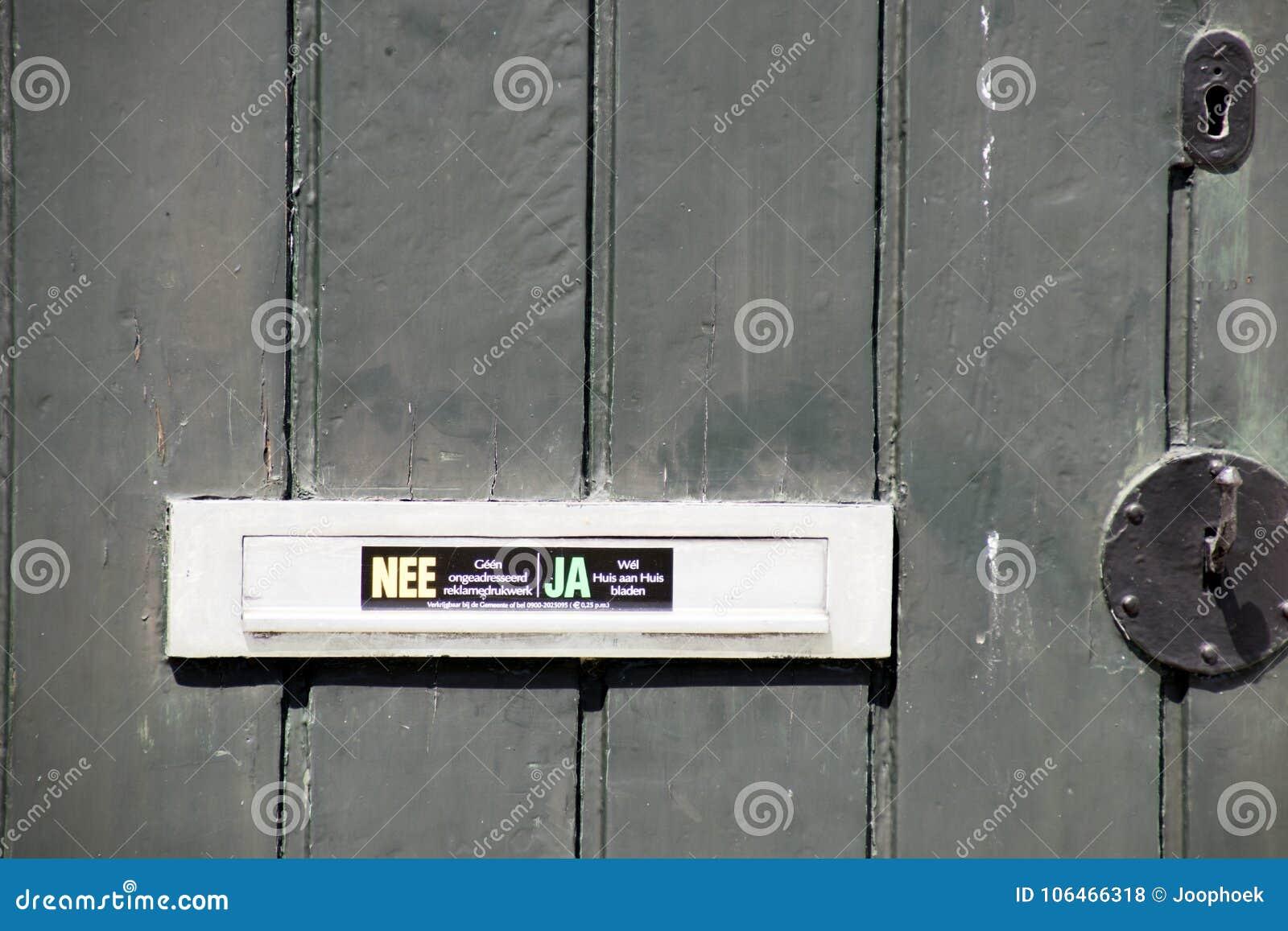 Netherlandsnorth hollandmarken june2016 wooden door with sticker for the mail man