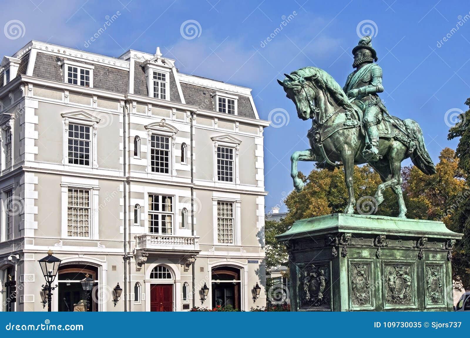 Statue William of Orange and old building The Hague