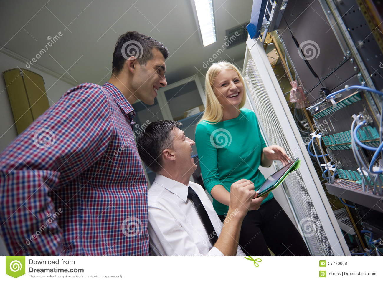 Network Engeneers Working In Network Server Room Stock