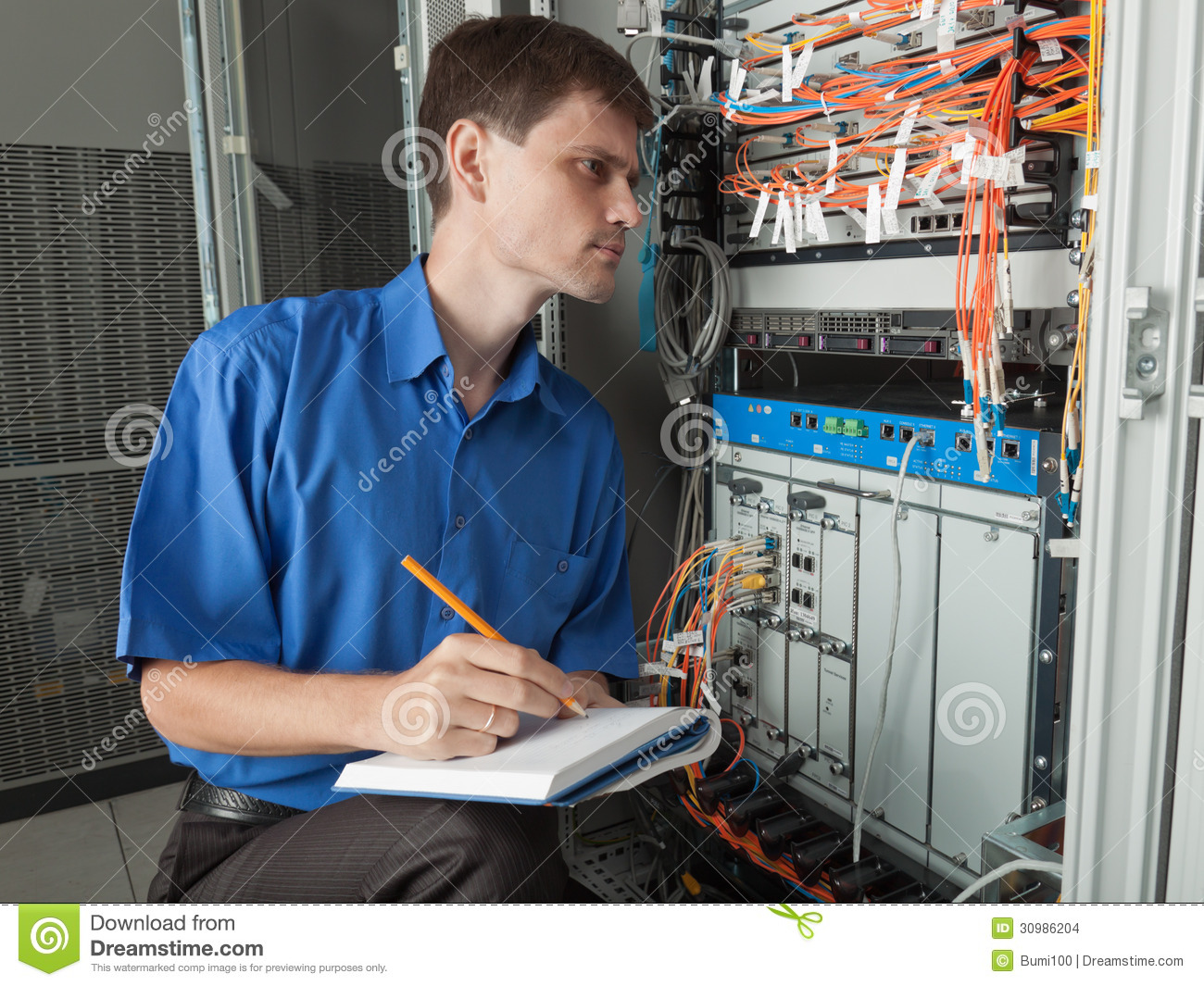 Network Engineer In Server Room Stock Photo Image Of