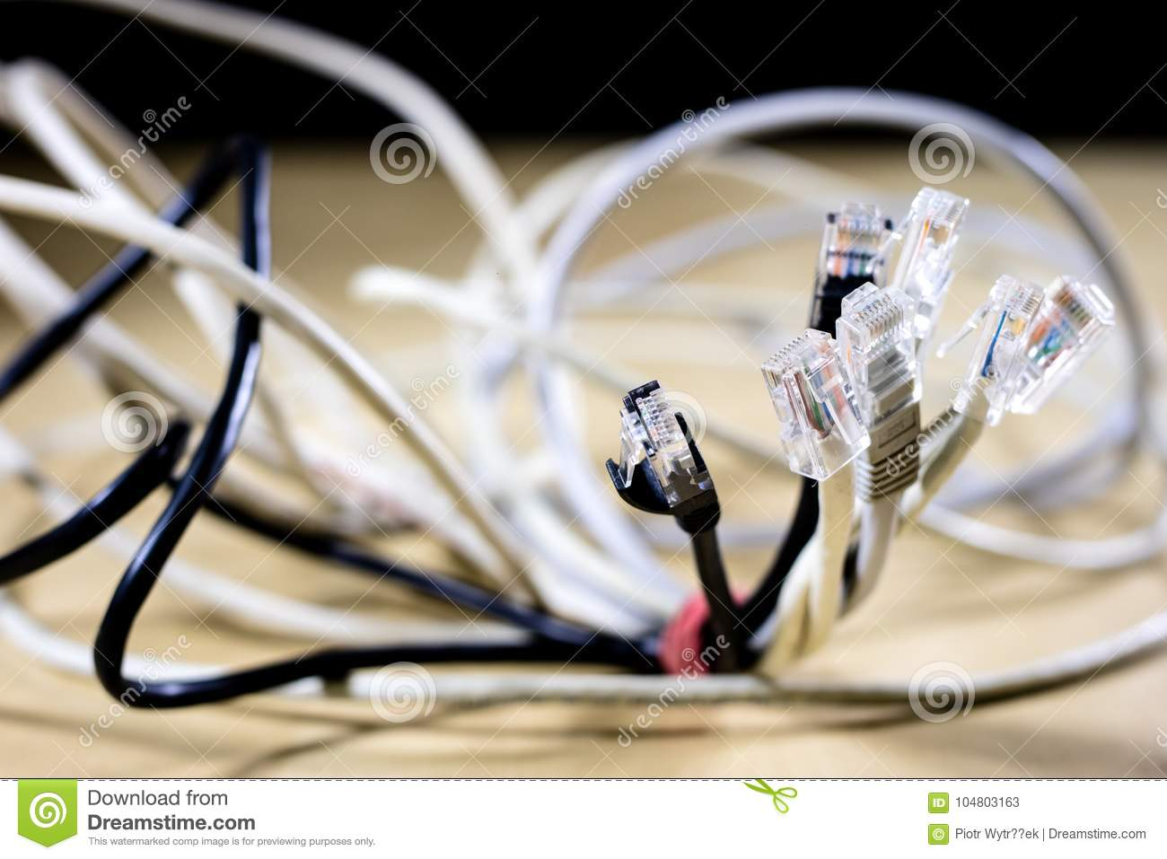 Network hub and rj45 cables on the stage. Computer accessories u