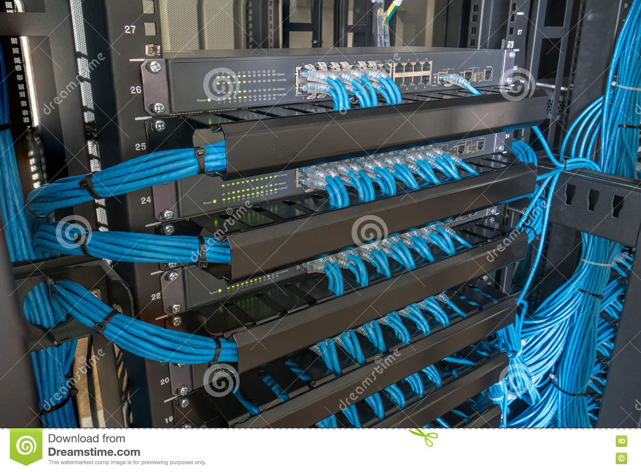 Network Switch And Ethernet Cables In Rack Cabinet Stock