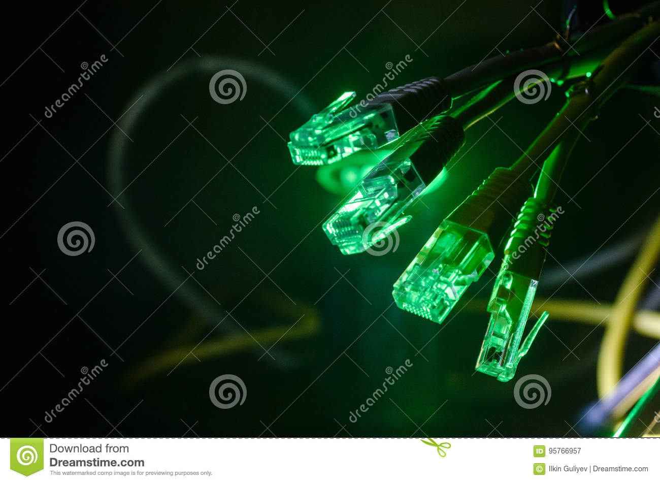 Network switch and ethernet cables, symbol of global communications. Colored network cables on dark background with lights and smo