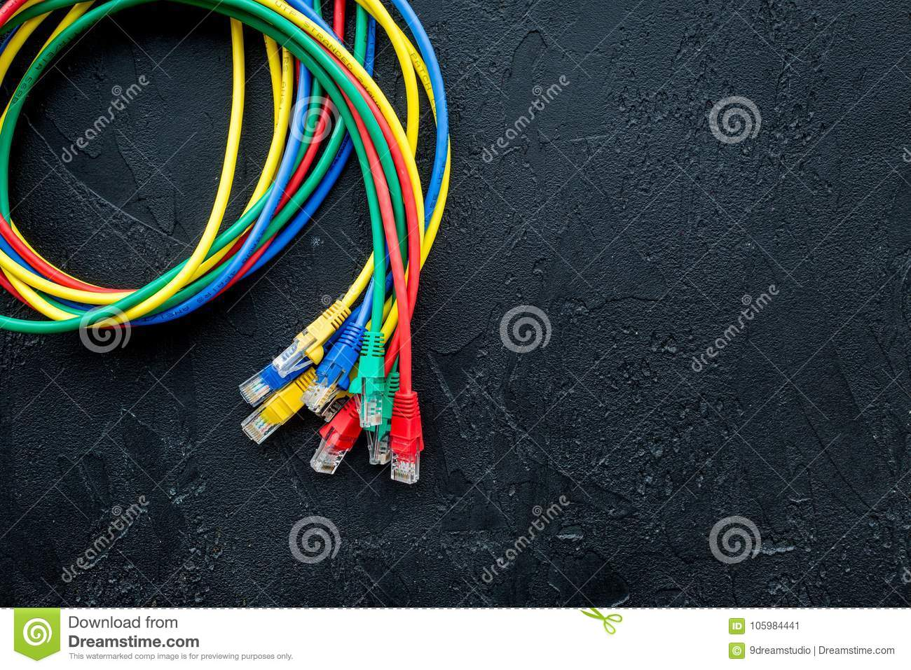 Network Wires Assorted Colors With Tips On Black Background Top View For Wiring Electric Copyspace