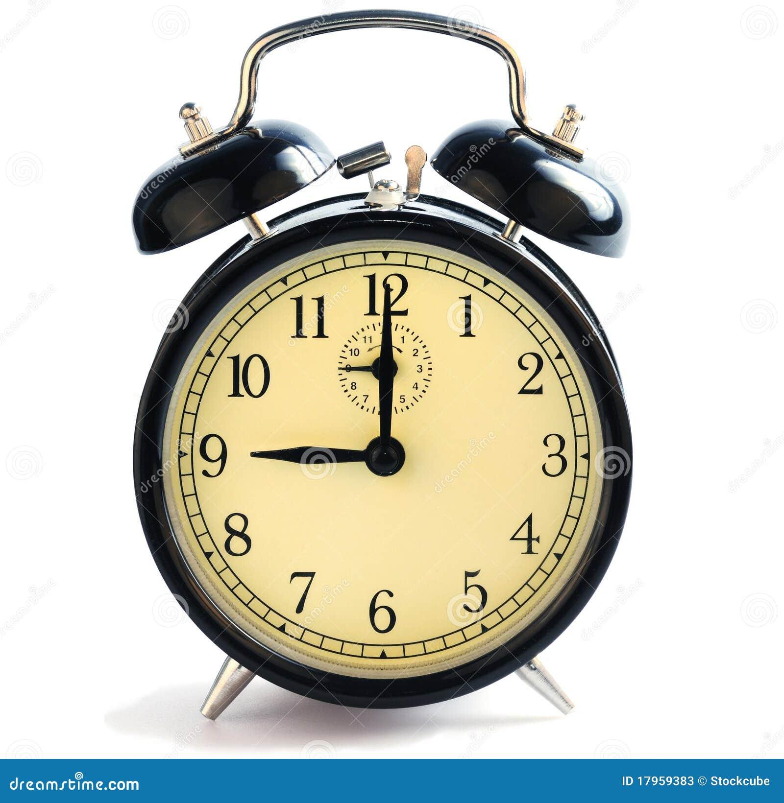 Eine altmodische alarmuhr die neun uhr zeigt