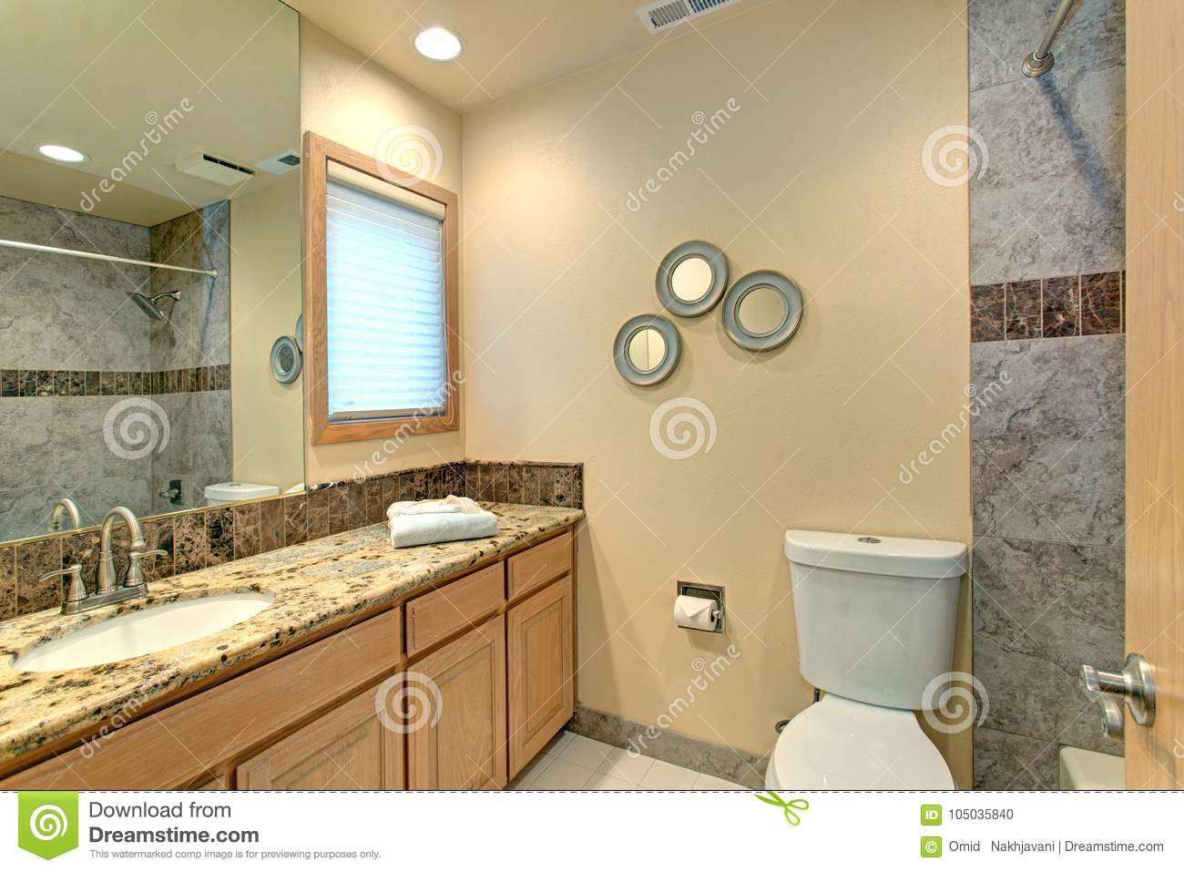 Neutral Bathroom Design With Green Marble Tile Stock Photo - Image ...
