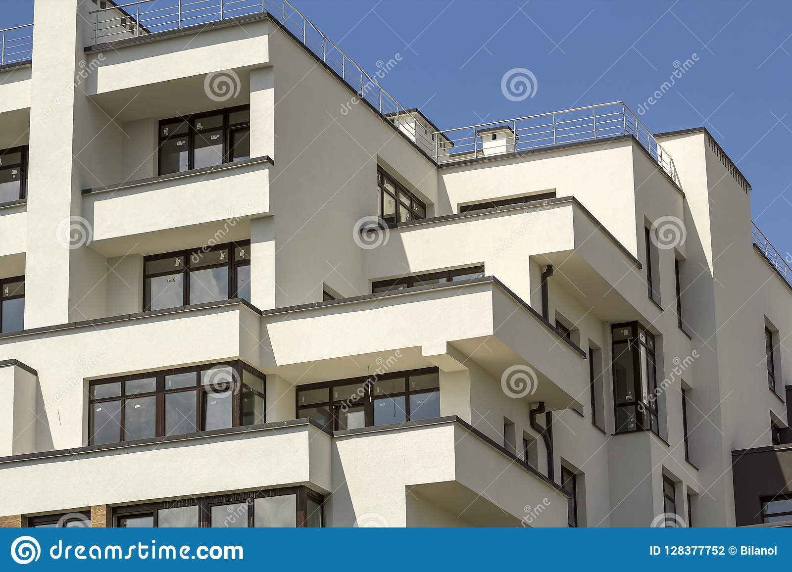 New Apartment Building With Terraced Balconies Shiny Windows And
