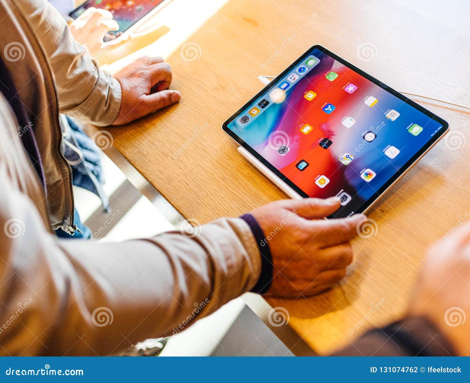 New Apple Computers iPad Pro tablet senior admiring tablet