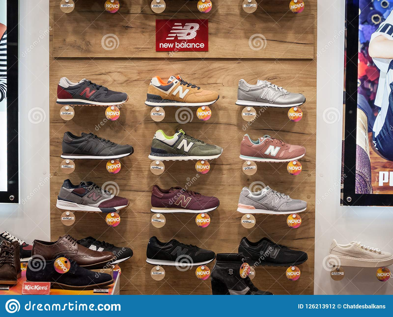 7100e5a556da New Balance Logo And Sneakers On Display In The Window Of Their Main ...
