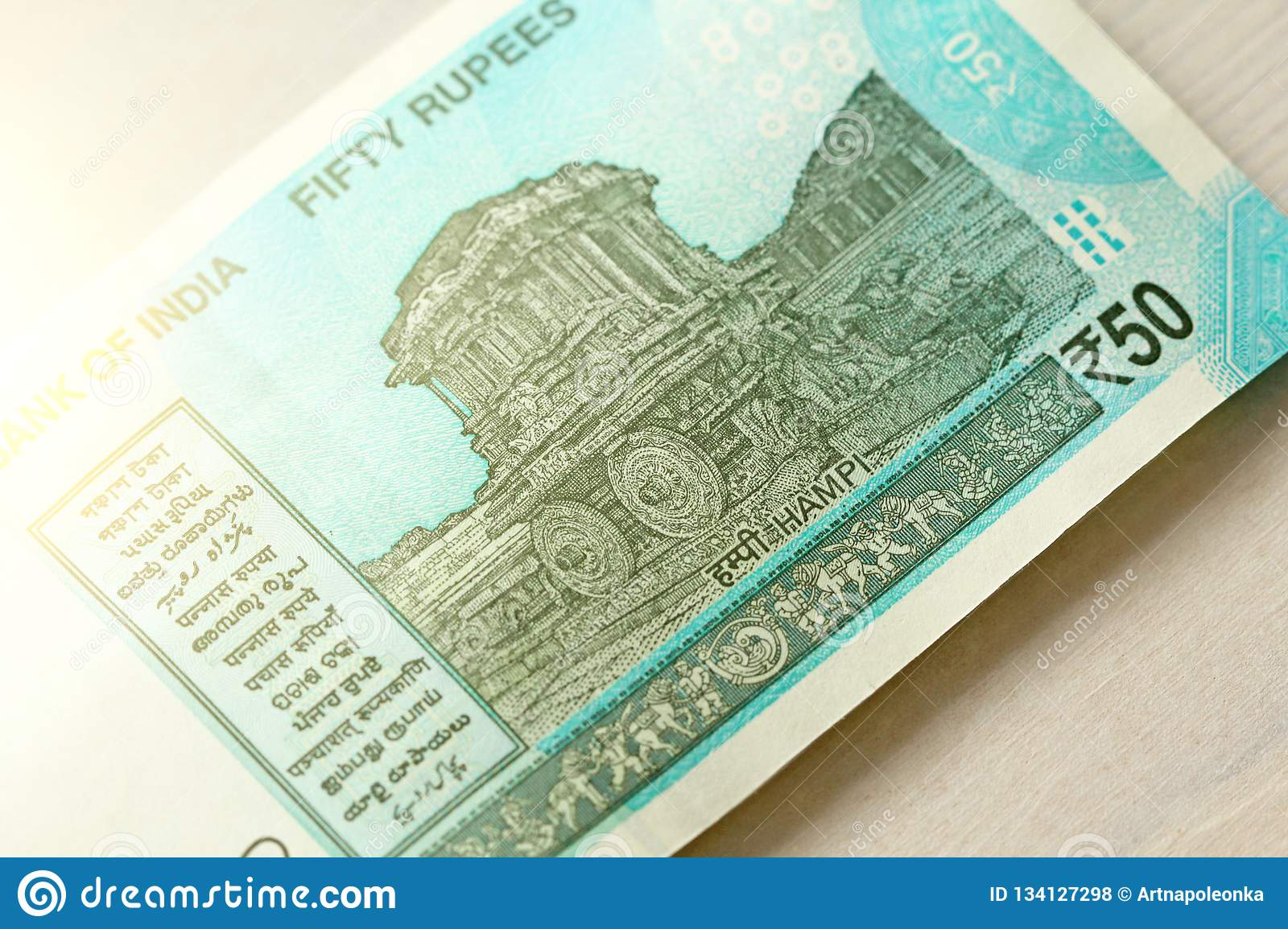 A new banknote of India with a denomination of 50 rupees. Indian currency. The other side, Hampi`s chariot