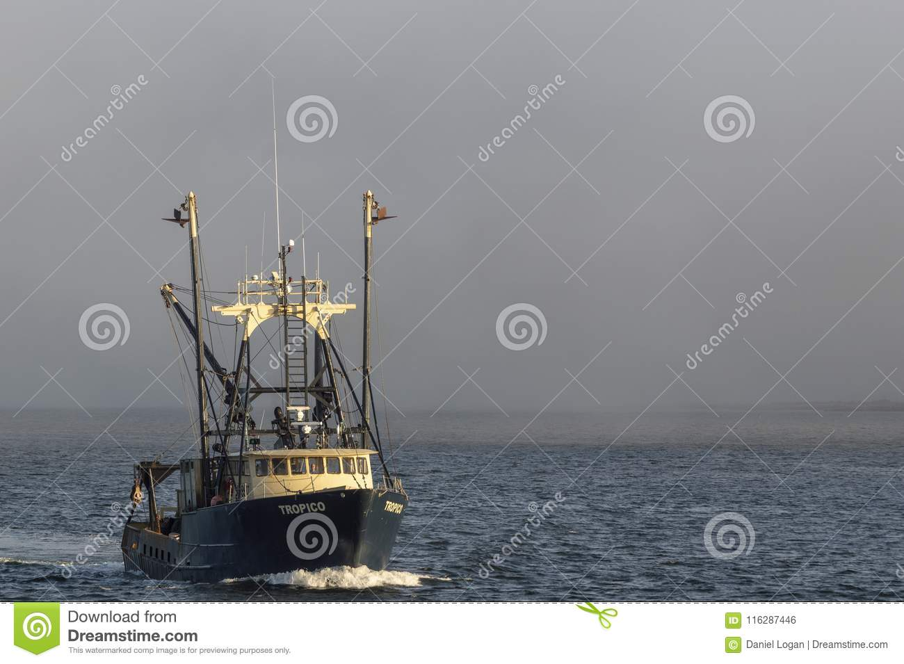 Commercial Fishing Vessel Tropico Lit By Setting Sun Editorial Photo