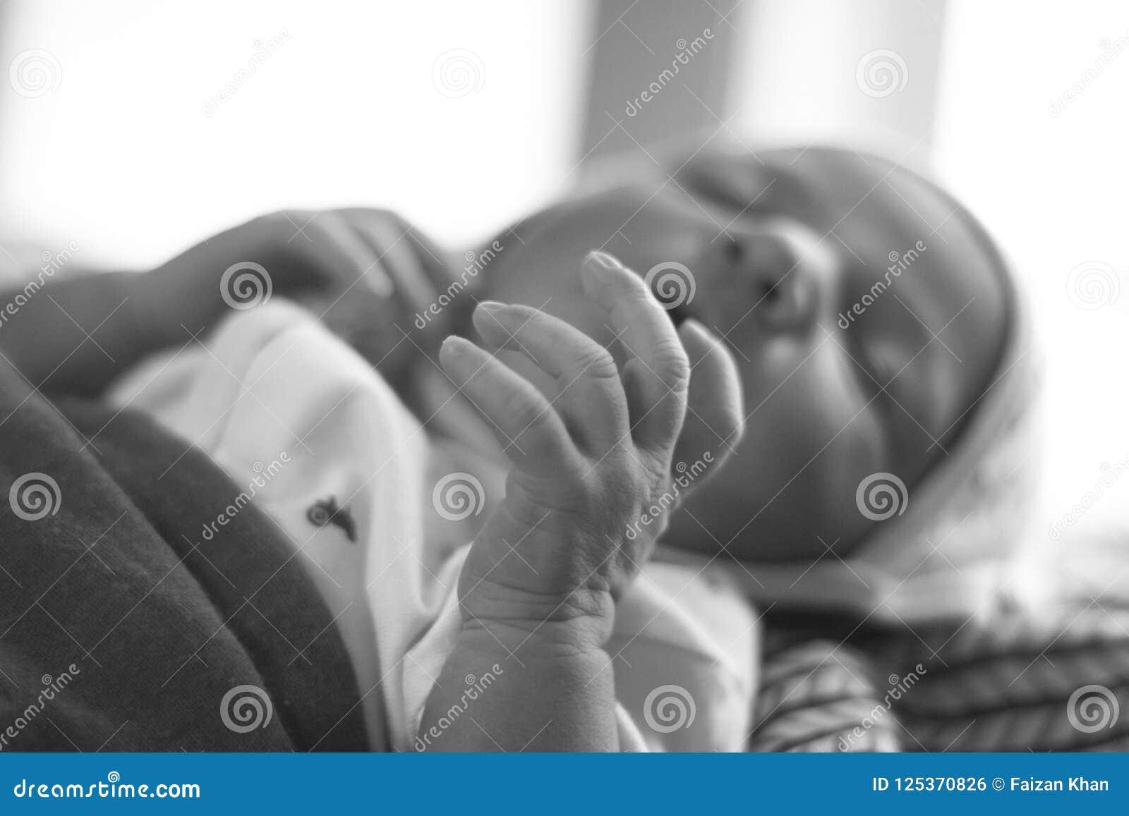 New born Baby hand black and white