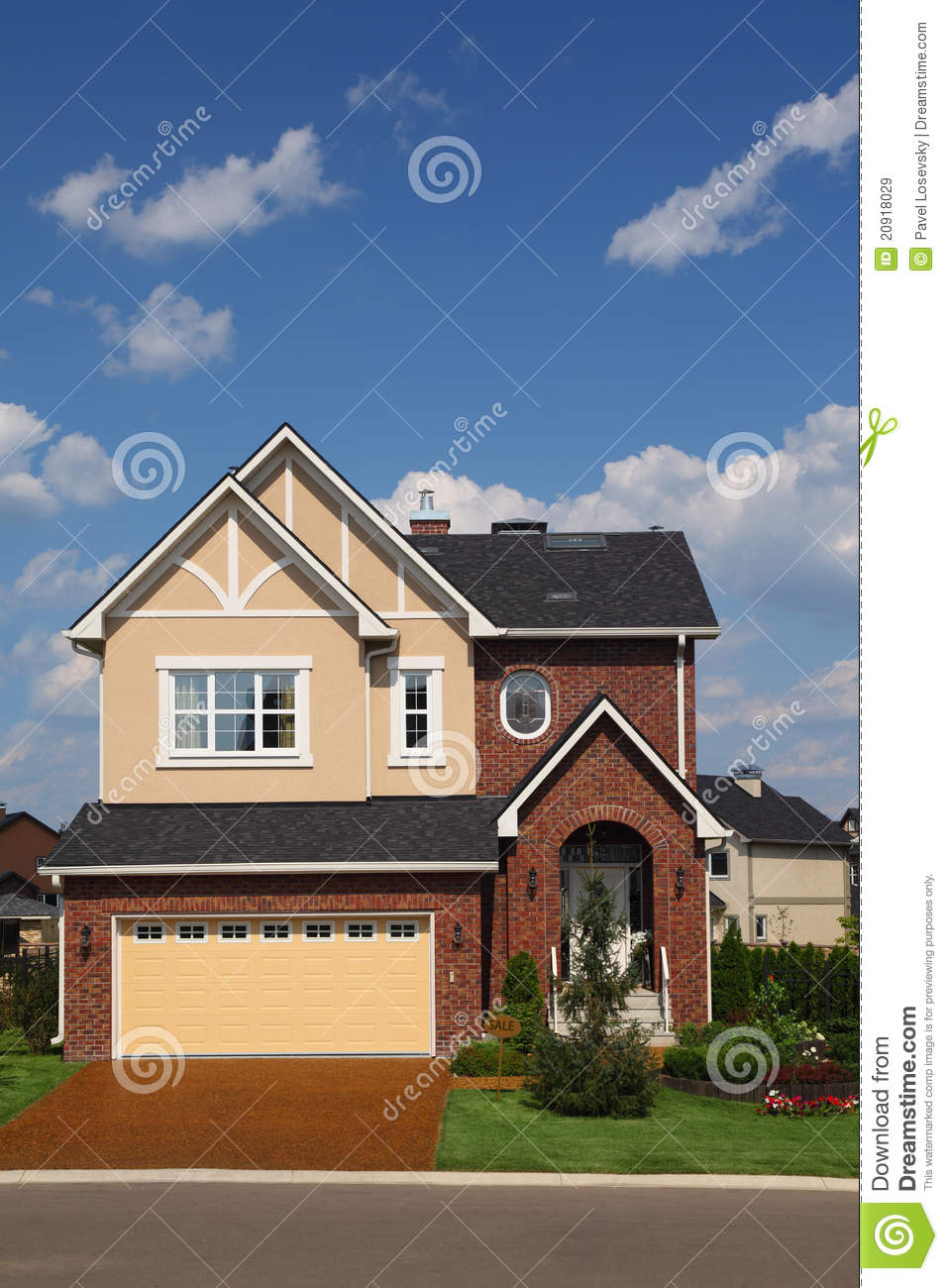 New brick cottage with garage and lawn royalty free stock for Brick garages prices