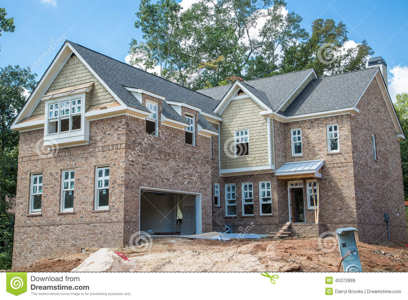 New brick home construction with sandpile stock photo for New brick homes