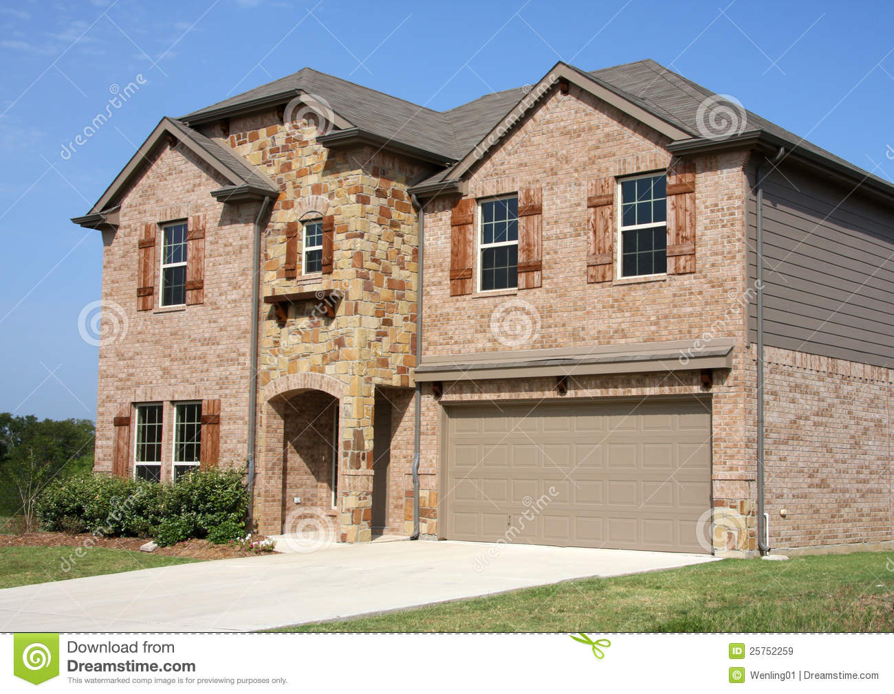 A new two floors brick house in suburban stock image for New brick homes