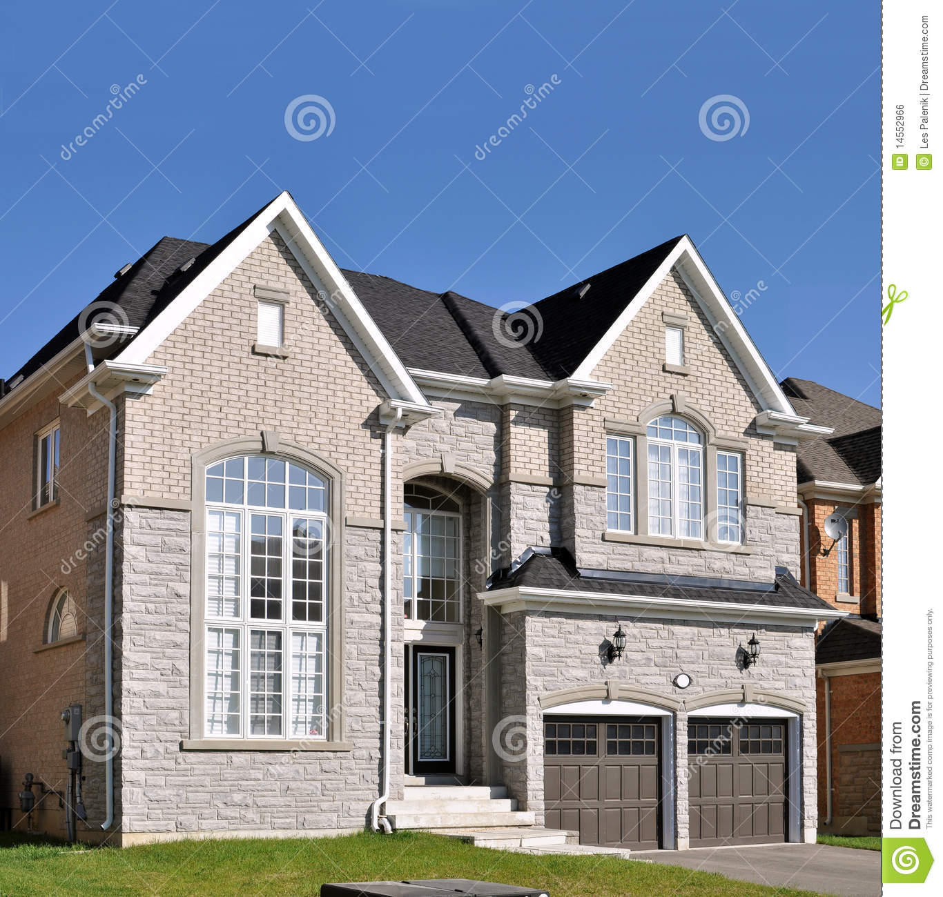 New Brick Homes: New Brick House With A Double Garage Stock Photo