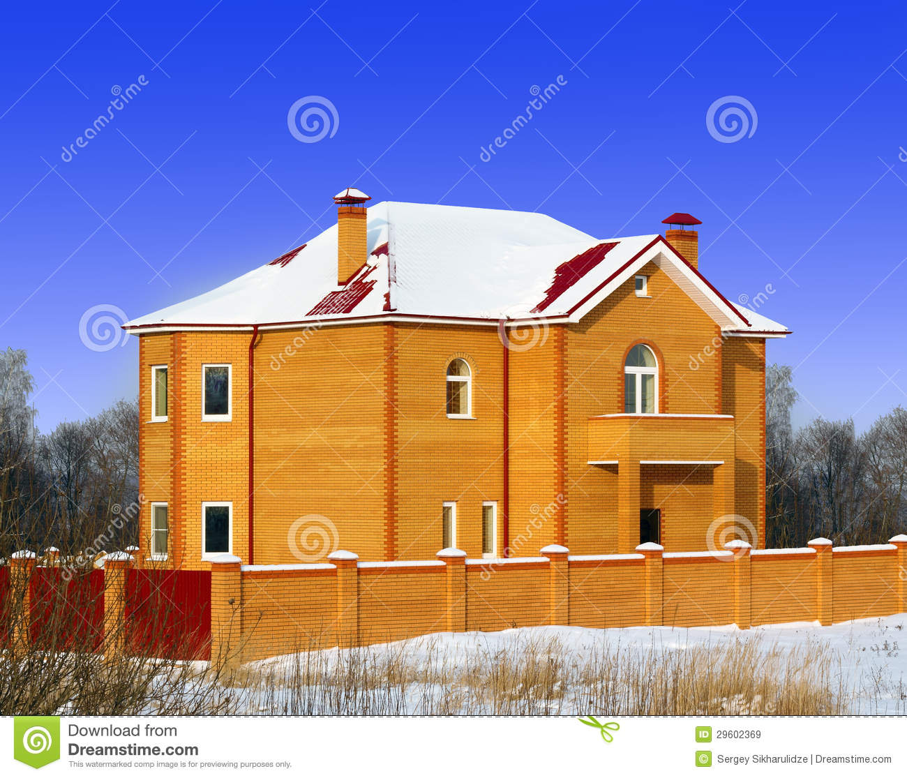 The new brick house with the red roof royalty free stock for Red brick house with metal roof