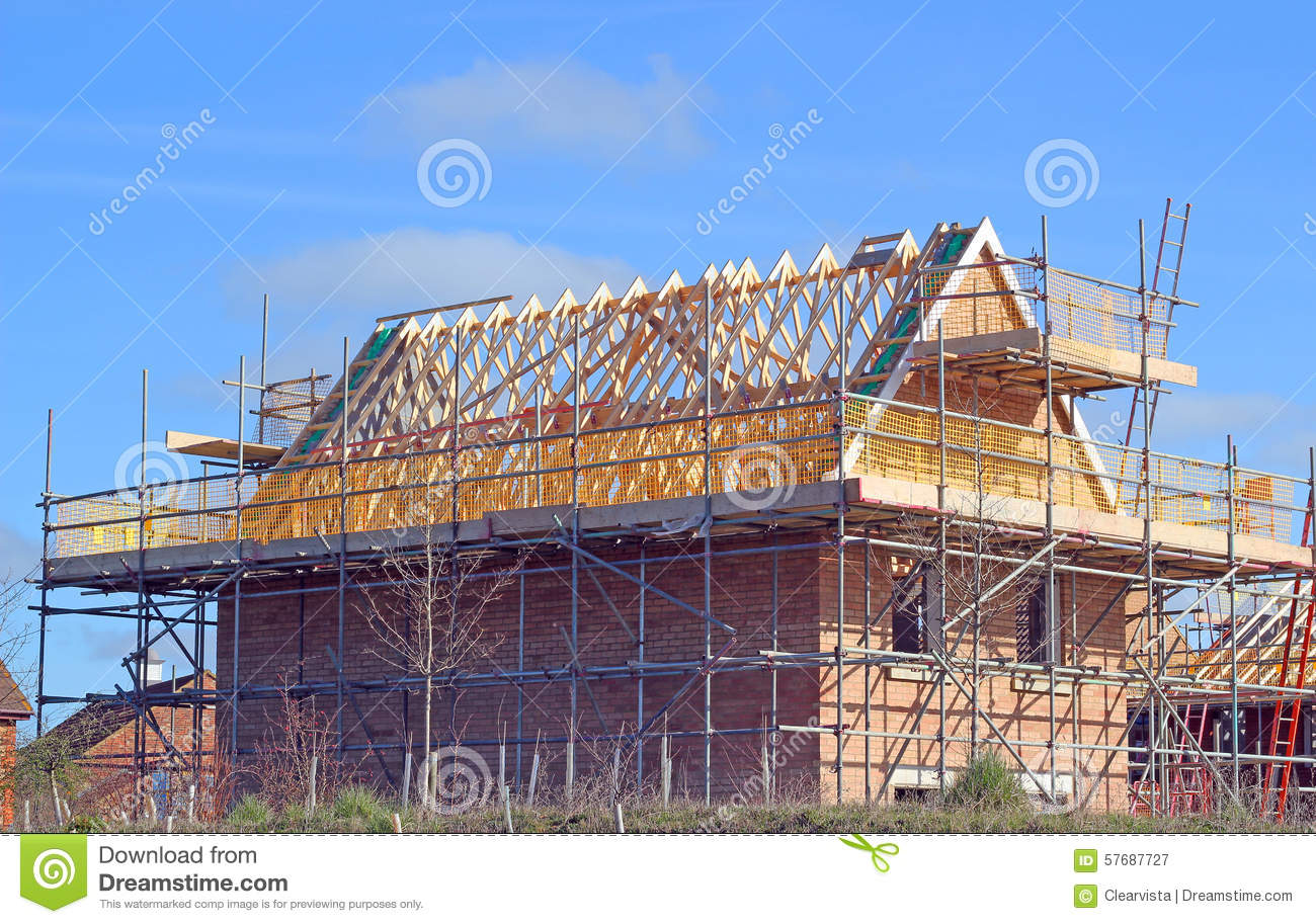 New build house with roof rafters and scaffolding stock for House roof construction