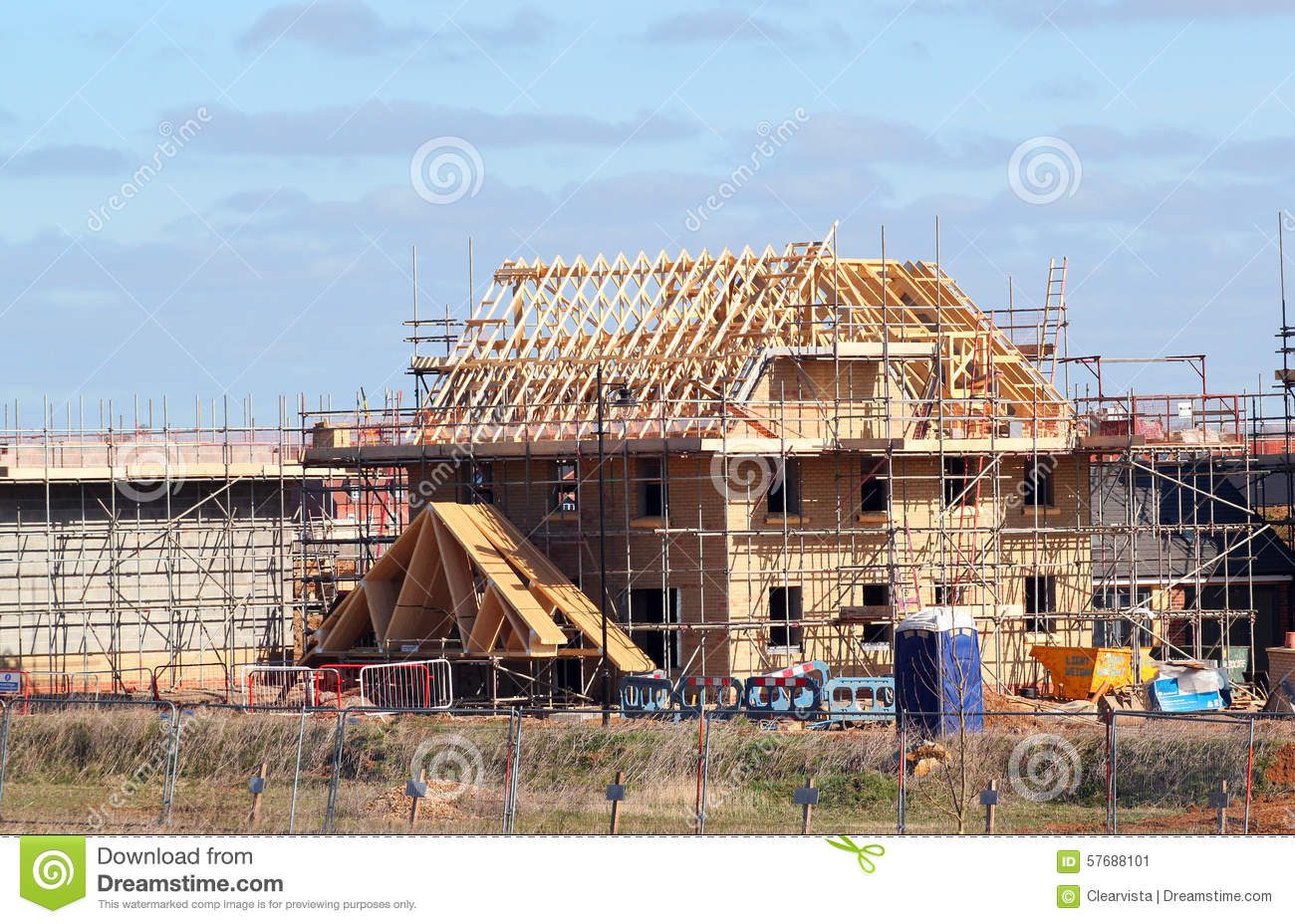 New build house with roof rafters and scaffolding for House roof construction
