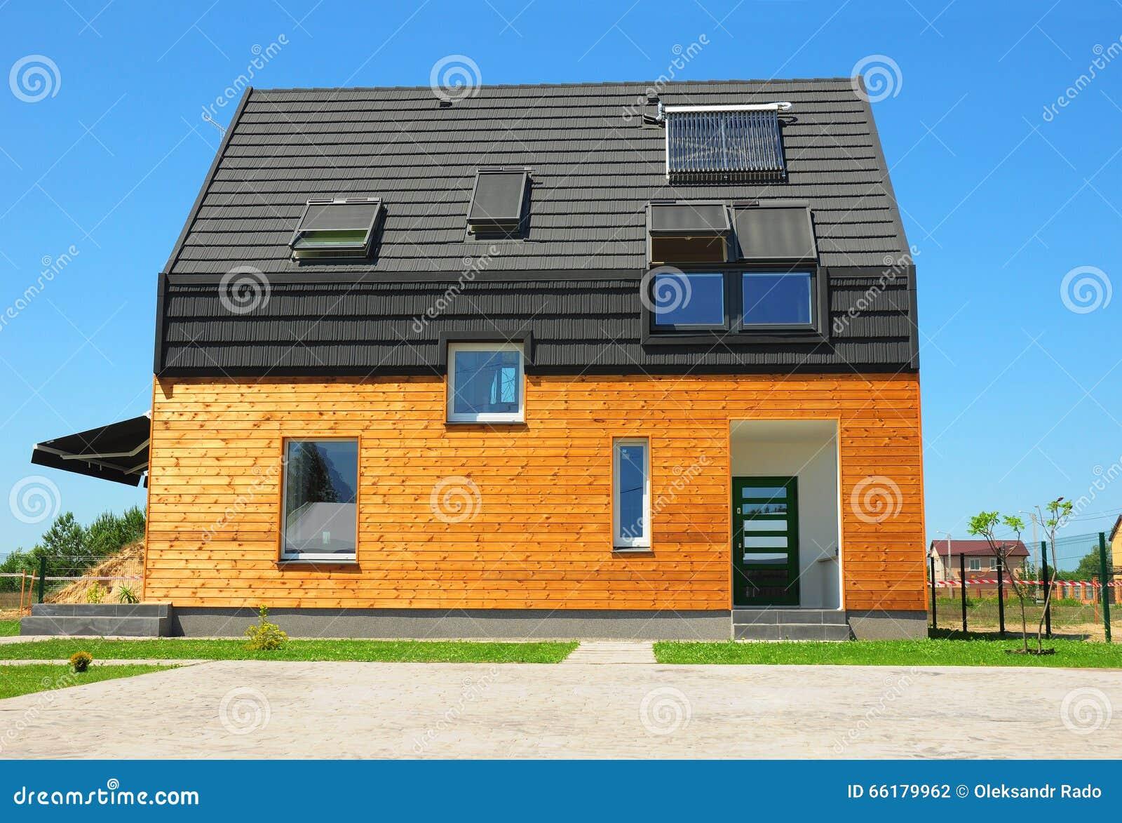 New Building House Energy Efficiency Solution Concept Outdoor. Solar Energy, Solar Water Heater, Solar Panels, Skylights, Ventilat