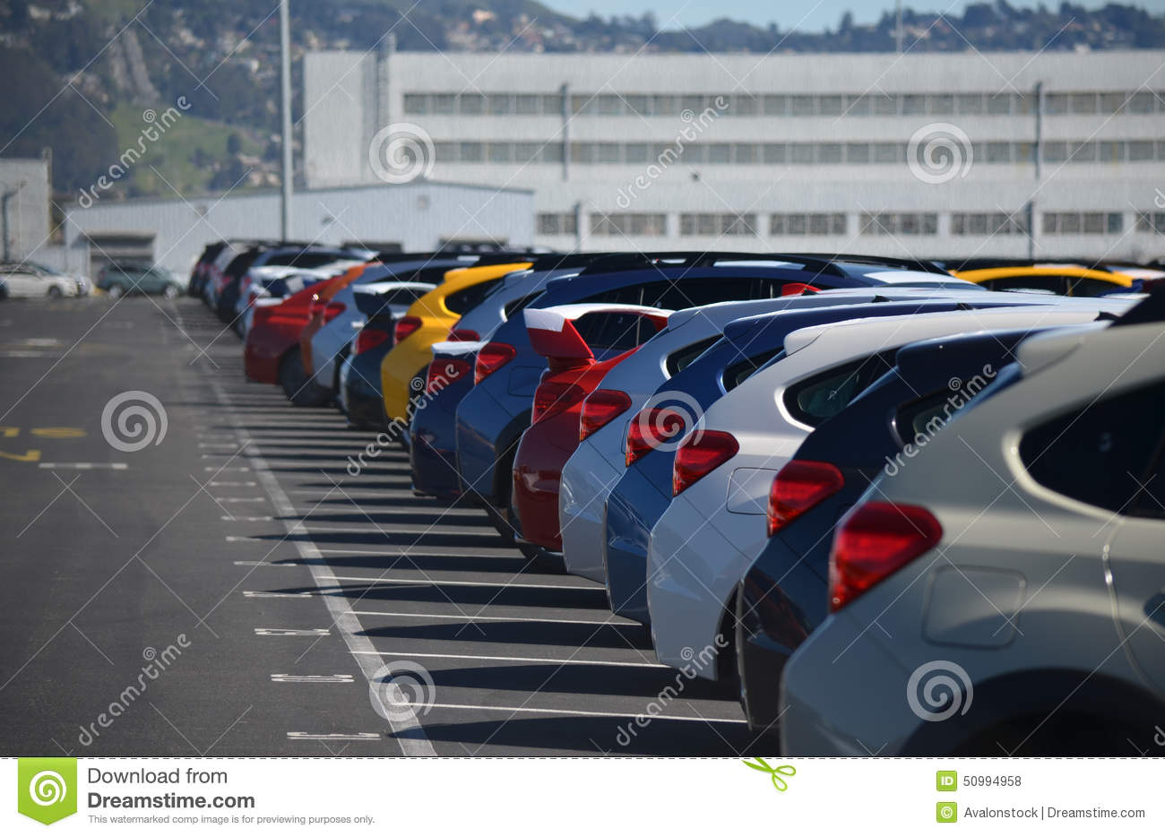 New Cars Lined Up in a Parking Lot
