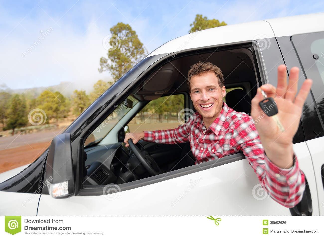 New cars - man driving car showing car keys happy