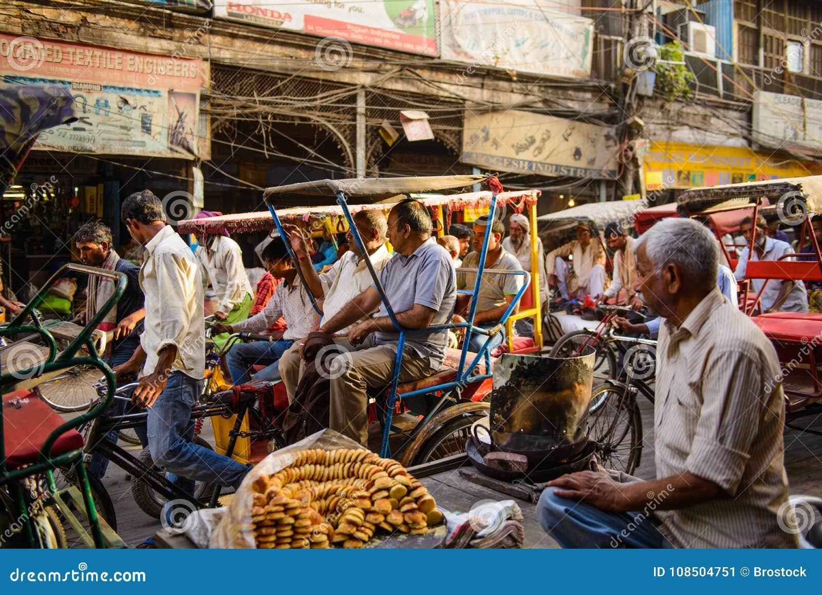 New Delhi, India - April 16, 2016 : Rickshaw rider transports passenger on April 16, 2016 in New Delhi