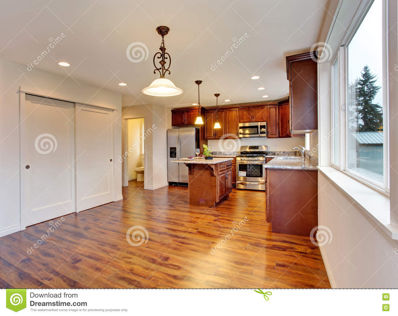 New Empty Dining Room And Kitchen Interior Stock Photo