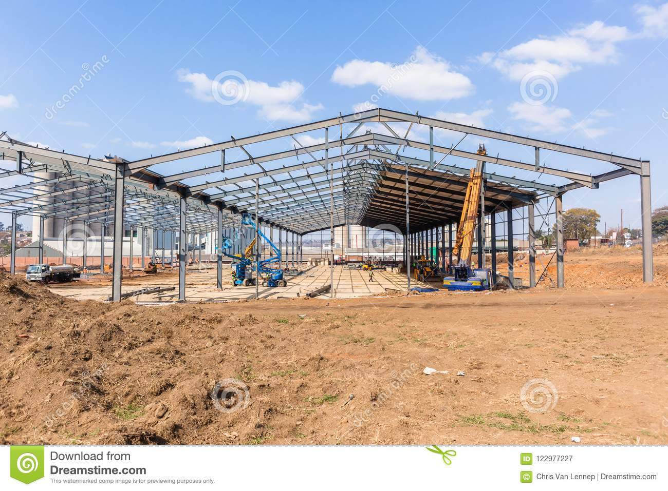 0eb052dd3cd New factory large warehouse construction steel beams frames assembled  halfway to completion of frame structure.