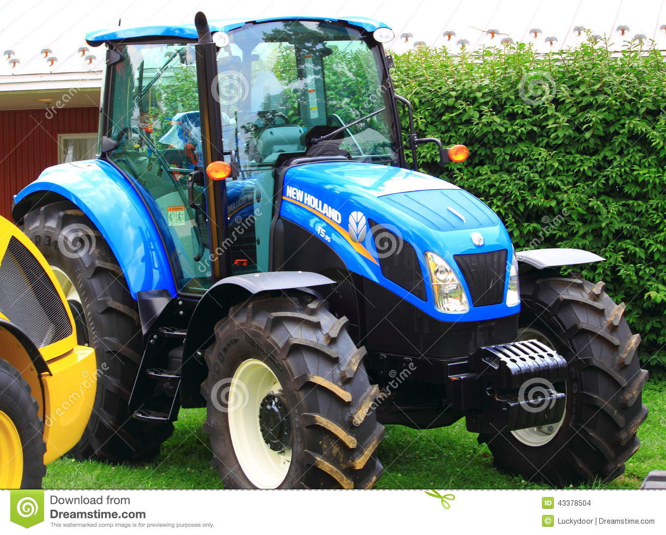 Blue Holland Tractors : New holland farm tractor editorial stock image