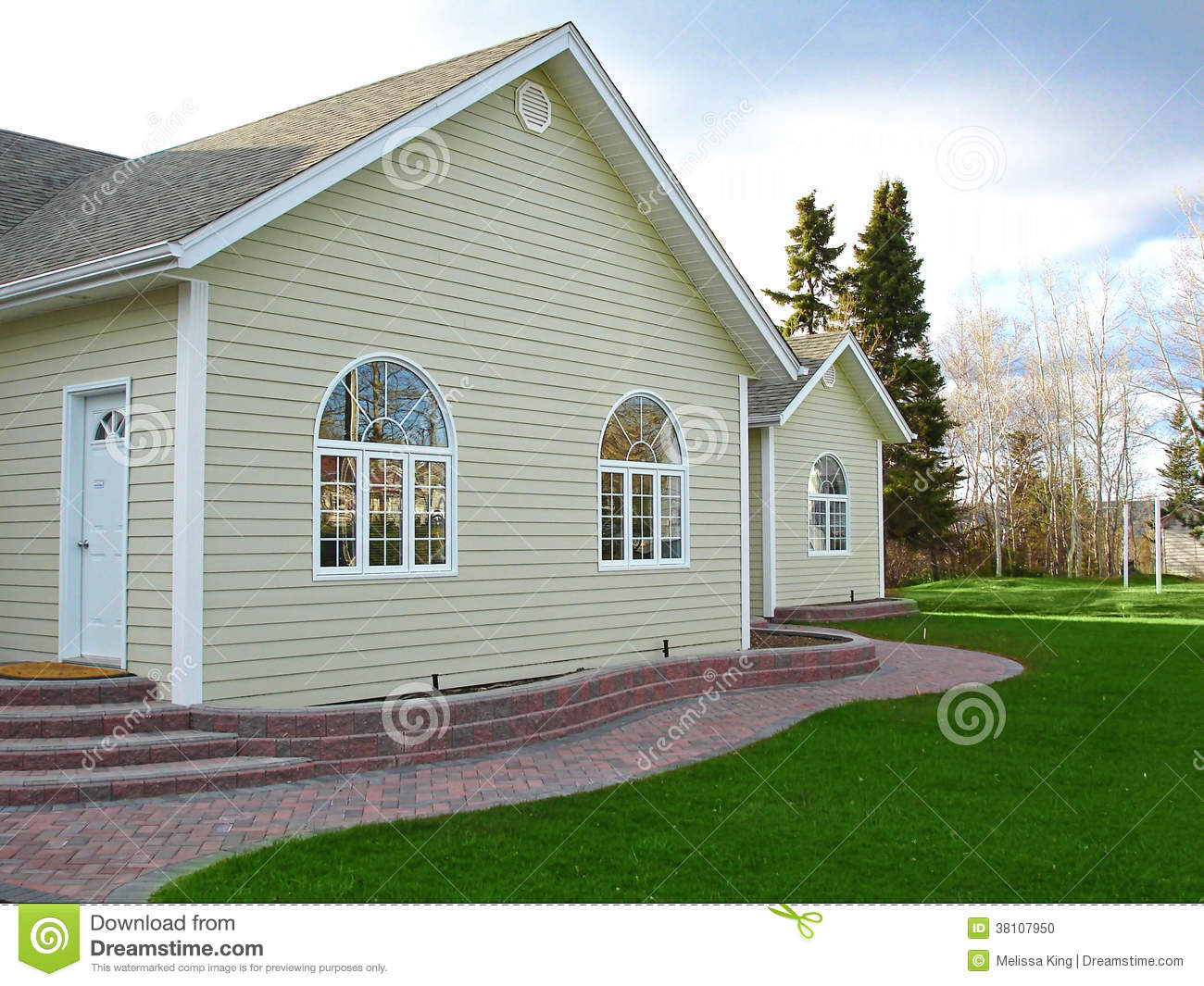 New home with brick walk and arch windows stock photo - Houses with arched windows ...