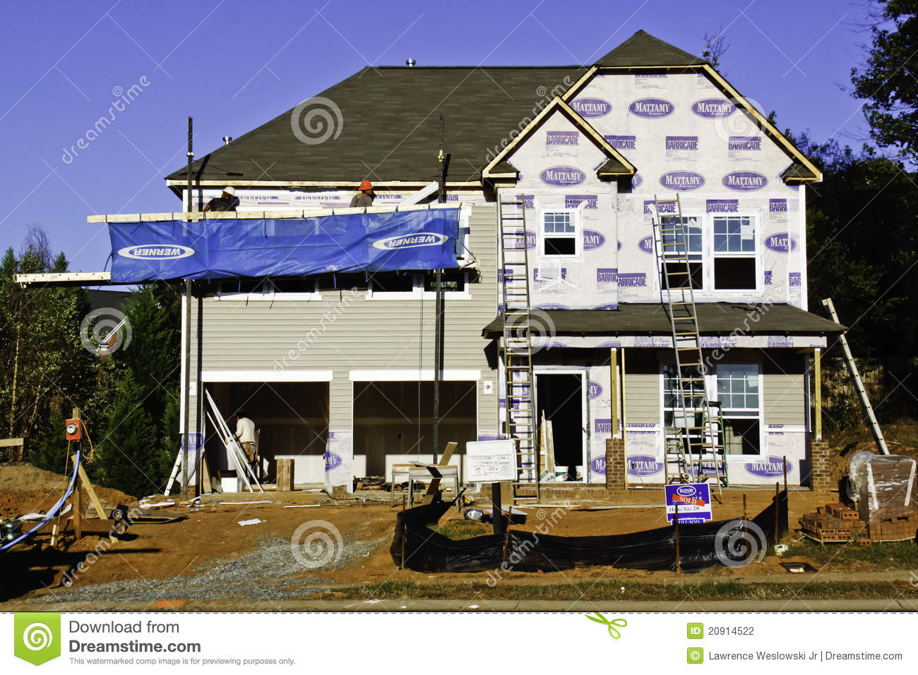 New Home Construction - Busy Work Site Editorial