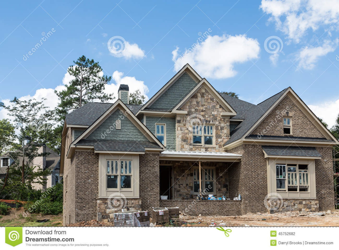 New Home Construction Of Stone Brick And Siding Stock
