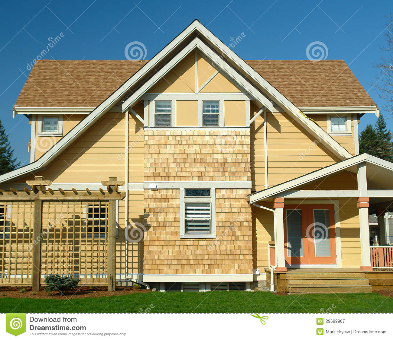 Home Exteriors: New Home Exterior Yellow Siding Stock Image