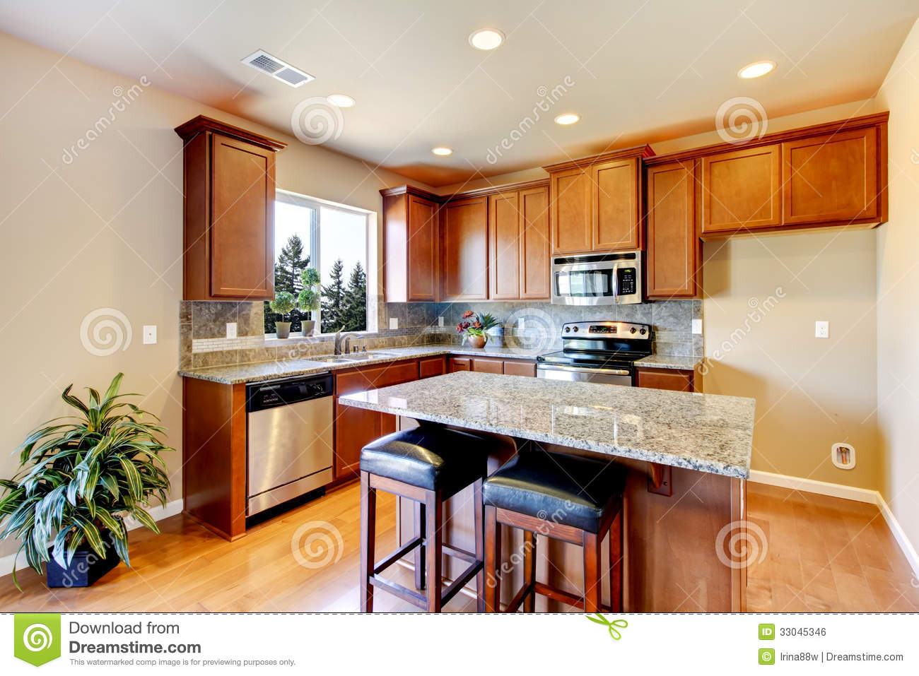 New Home Kitchen Interior With Dark Brown Cabinets Stock