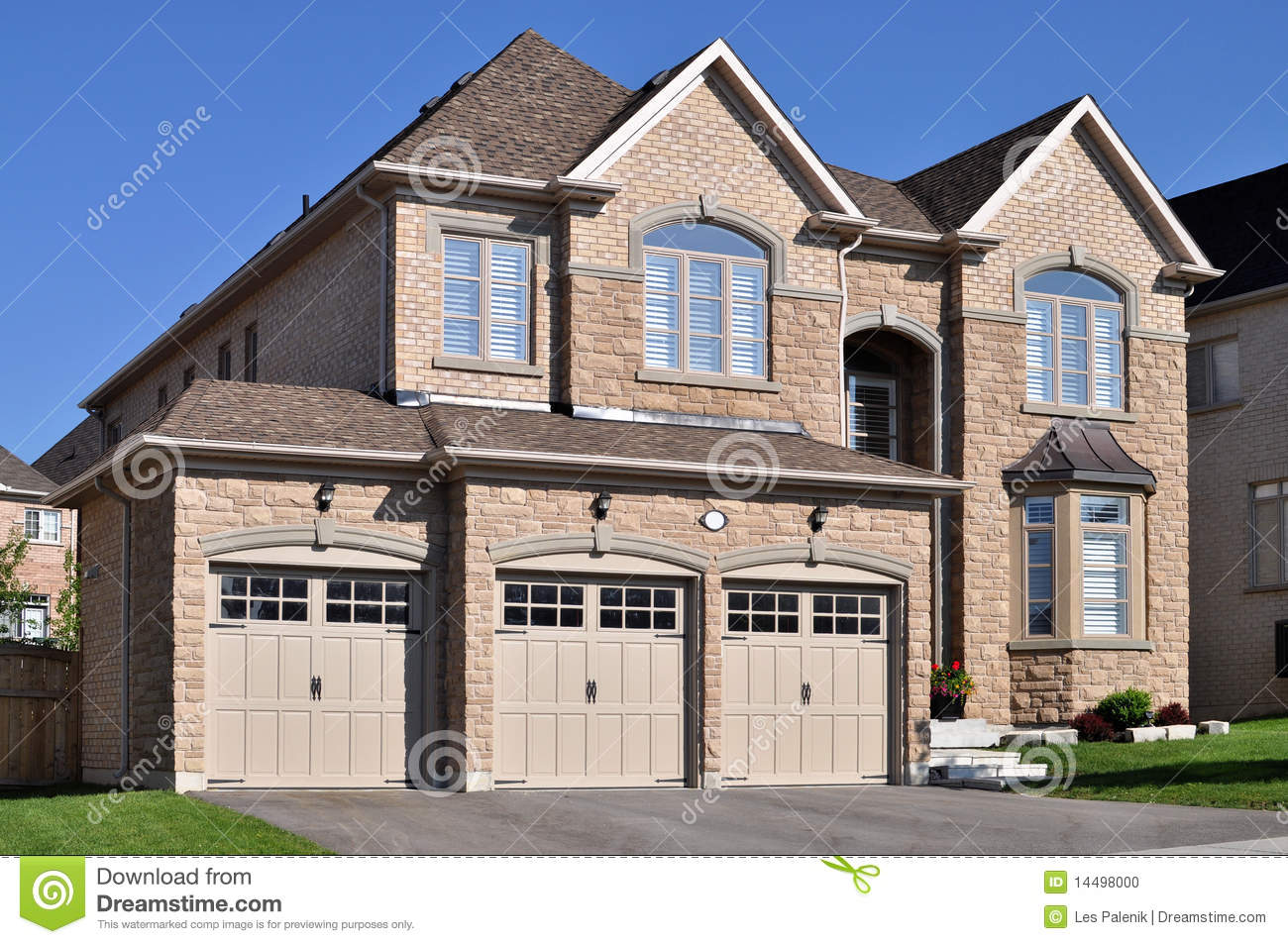 New home with a triple garage