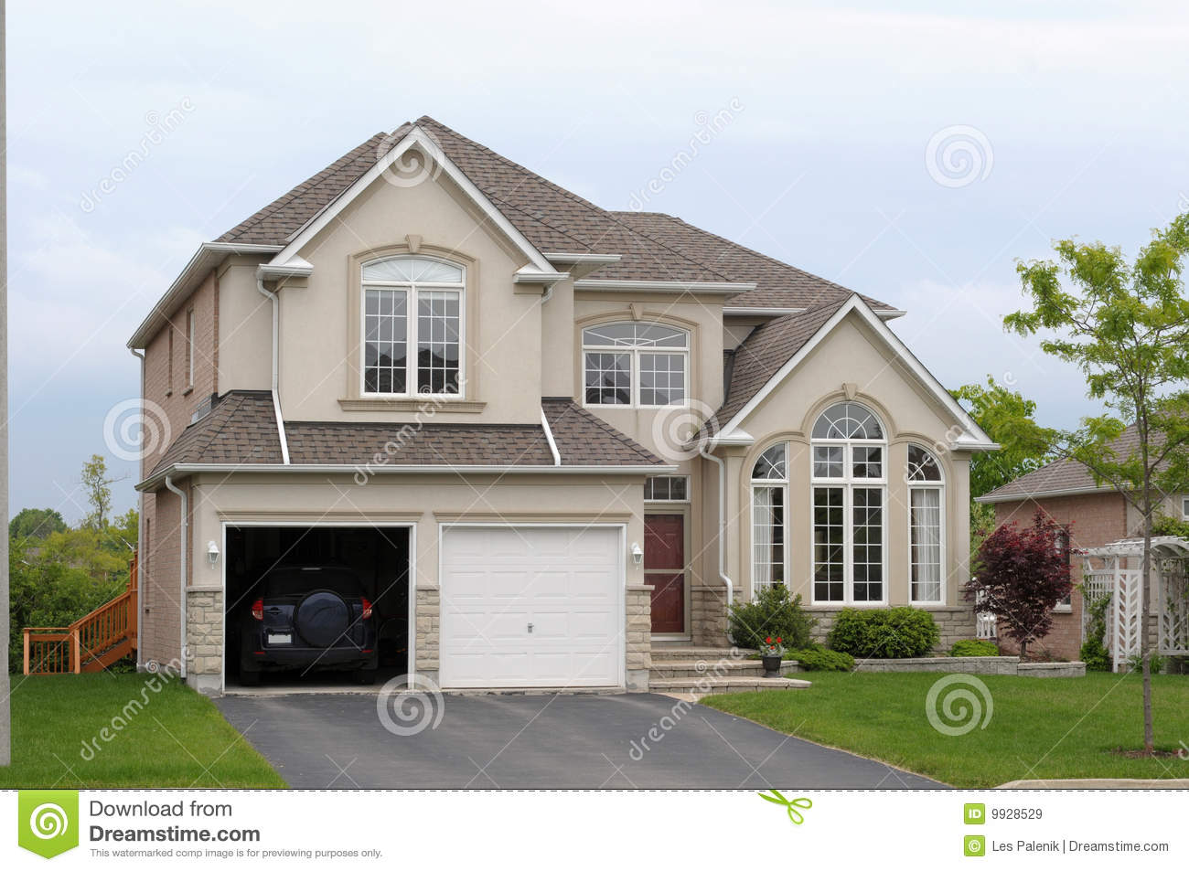 New house with a double garage royalty free stock images for New house images