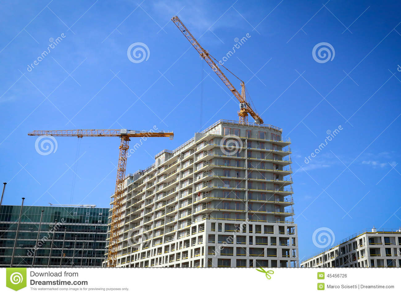 Crane on a construction site houses stock photo for Building site house