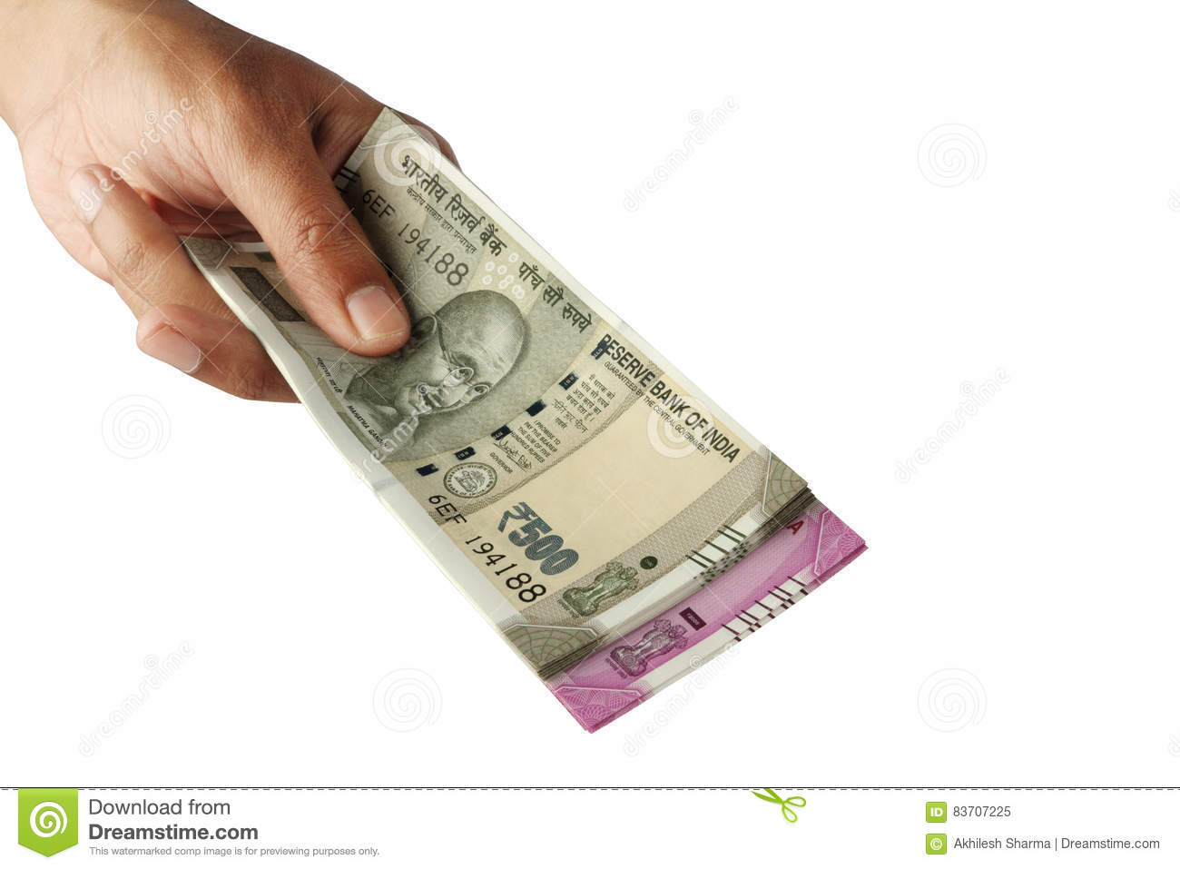New Indian Rupee Currency Notes In A Hand On White Stock Photo