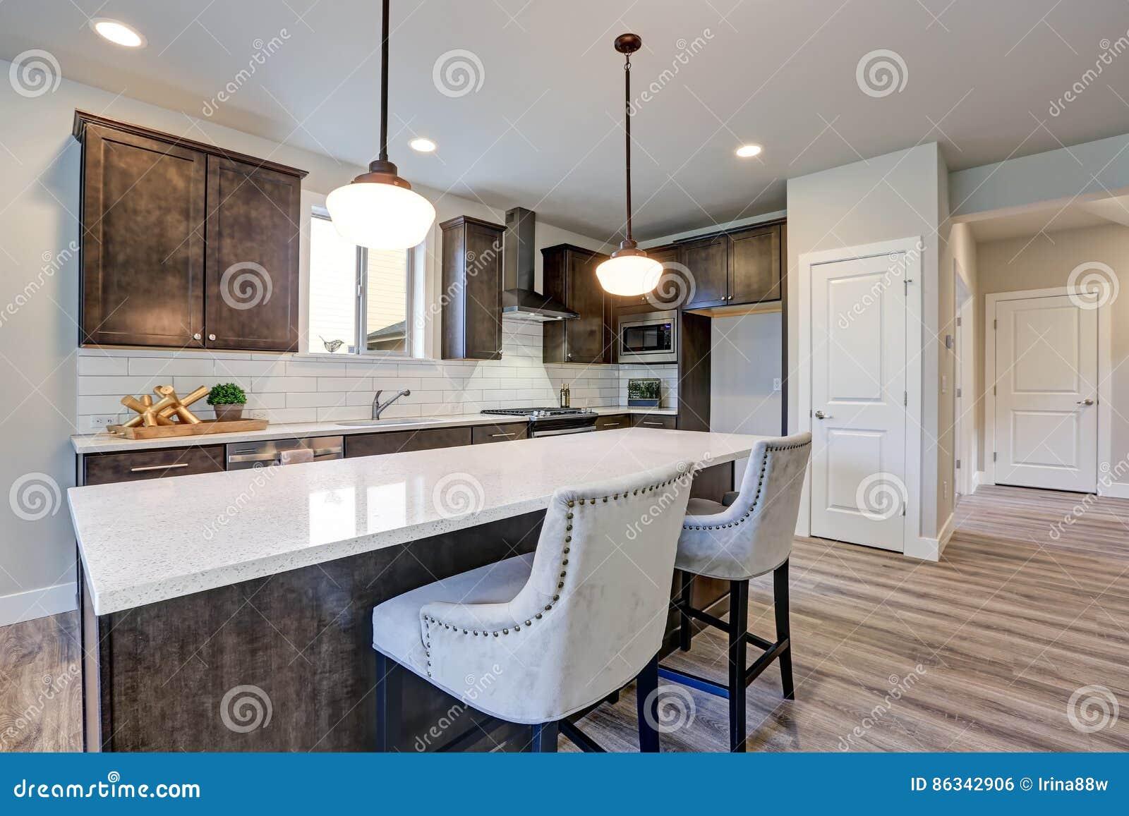 New Kitchen Boasts Dark Wood Cabinets Large Island Stock